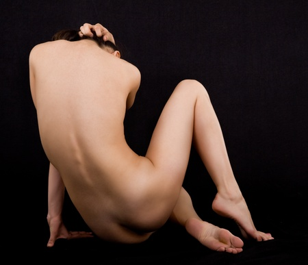 naked female body on a black background Stock Photo - 11866484