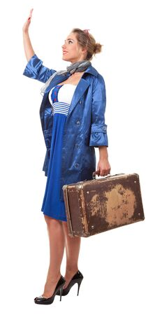 young woman dressed in retro style with an old suitcase photo