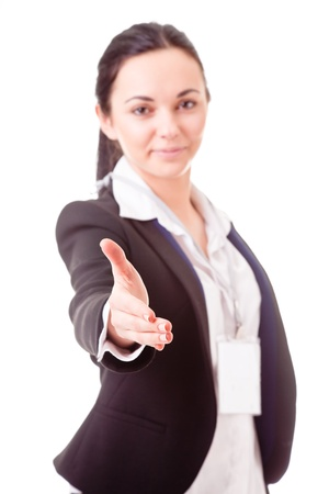 Girl in office clothes stretches out hand for a handshake Stock Photo - 12565528