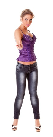 fuck: provocative portrait of a young woman in jeans and corset Stock Photo