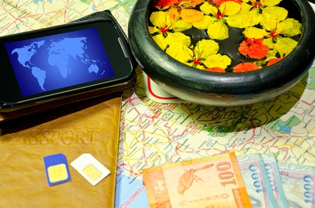 smartphone, cash, sim card on a map of Ceylon photo