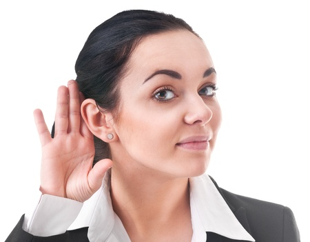 Young woman in office attire listens attentively Stock Photo - 12565724