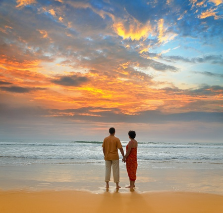 couple of adults on ocean shore at sunset Stock Photo - 12565577