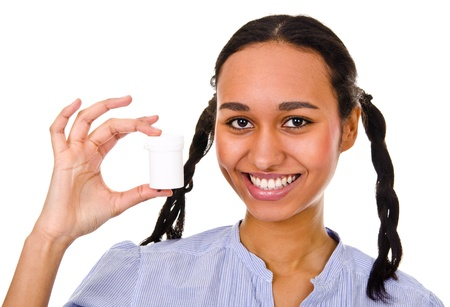 young afro-american woman holding a container with medicament Stock Photo - 12565725