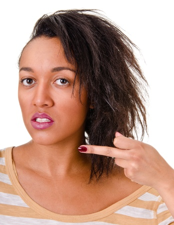 Portrait of a young woman shows middle finger  on a white background. photo