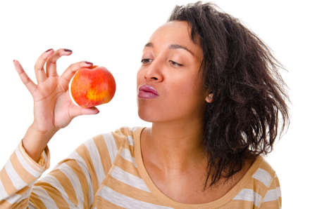 Portrait of an attractive girl with a ripe apple on a white background photo