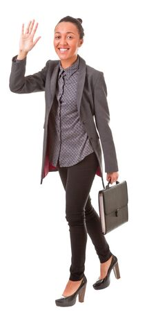 Portrait of a young business woman waving hand on a white background Stock Photo - 12565692