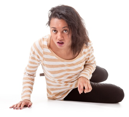 aggressive dark skinned girl in a striped T-shirt and leggings on a white background photo