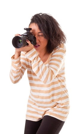 attractive dark skinned girl with a camera on a white background photo