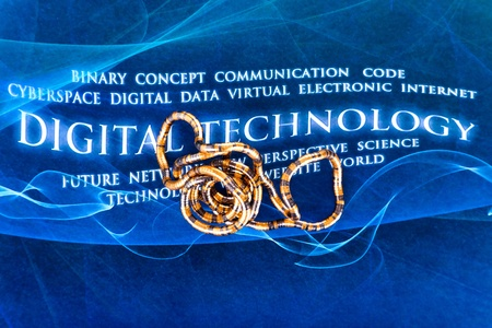 flexible metal pipe against a futuristic background with the words DIGITAL TECHNOLOGY Stock Photo - 12565574