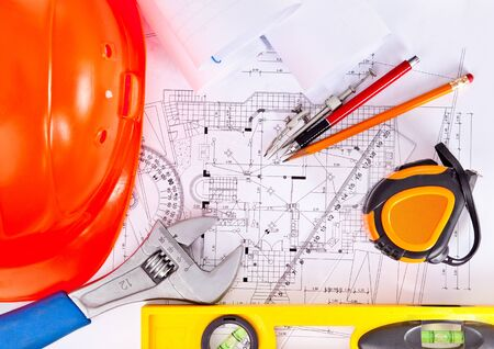 tools are located on the drawings, engineering background Stock Photo - 12565578