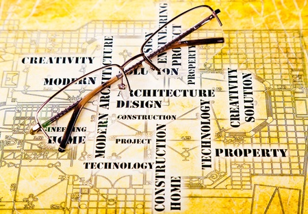 glasses lie on the ancient art engineering background Stock Photo - 12565572