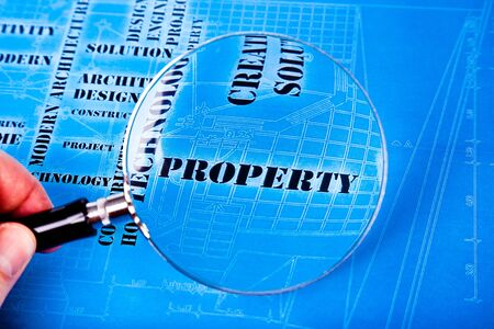 human hand with a magnifying glass on the art architectural background Stock Photo - 12565558