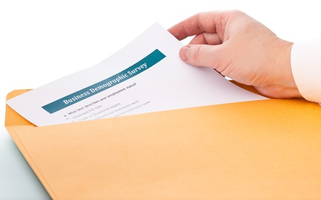 envelope: hand takes the paper from the envelope Stock Photo