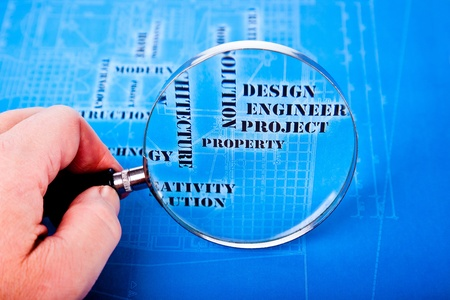 human hand with a magnifying glass on the art architectural background Stock Photo - 13251219