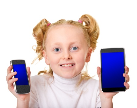 school-aged girl holding unrecognizable smartphone and tablet photo