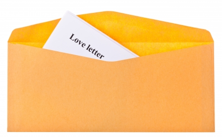 open envelope with looking out the corner of the letter photo