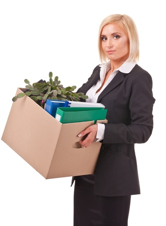 young business woman holding a box of belongings and documents photo