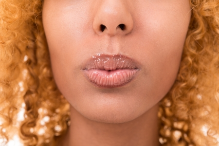 lips of a young woman is very close Stock Photo - 16300384