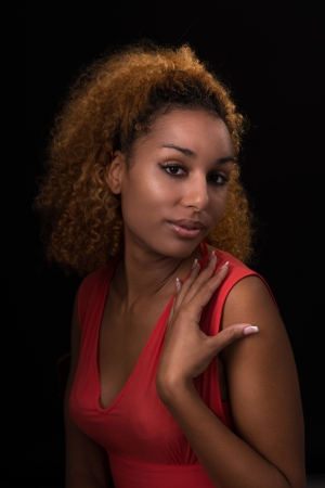 art portrait of a young woman in dark colors photo