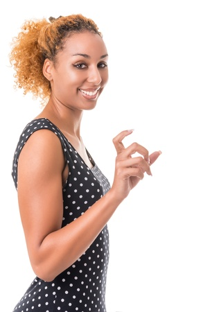 young woman holding something in her hand. Isolation on a white background photo