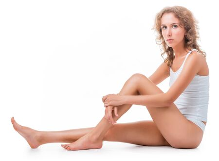 figure of a seated young woman in lingerie. Isolation on white background Stock Photo - 16300446