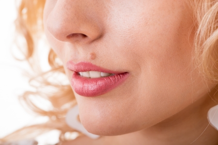 part of a womans face with a mole close-up Stock Photo