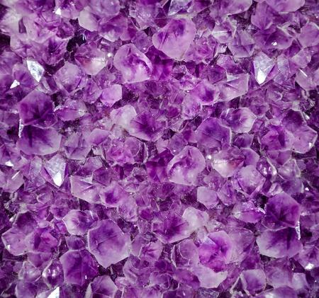 amethyst rough: Natural amethyst crystal background. Amethyst is a violet variety of quartz