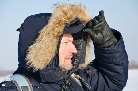 Portrait of a traveler in winter clothes in an outdoor photo