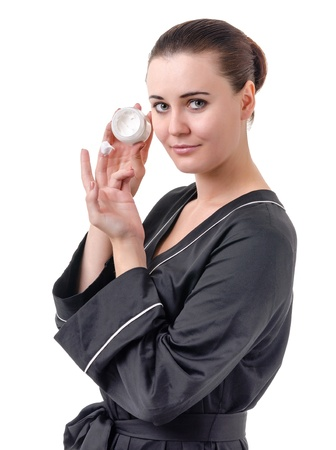 real young woman in a black bathrobe over a white background photo