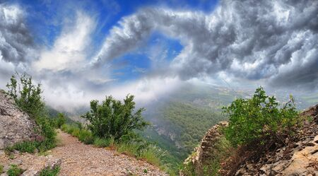 magnificent mountain landscape with clouds and fog relief Stock Photo - 18487648