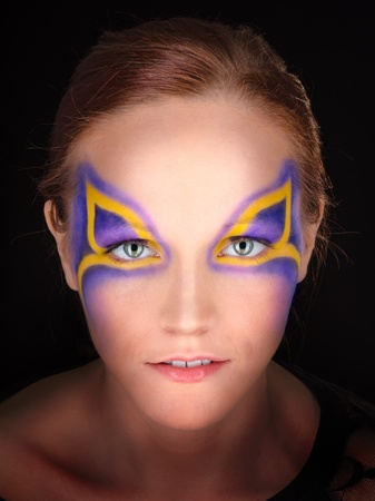 portrait of a young woman with fantasy makeup photo
