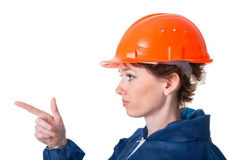Portrait of a woman in protective clothing and helmet. Isolation on white background with a clipping paths photo