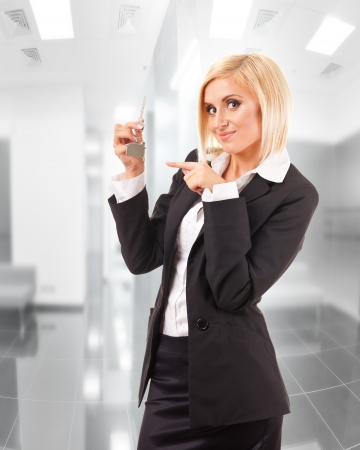young business woman in front of office background photo