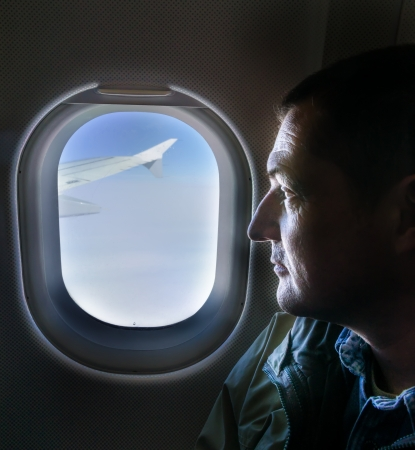 man looking into the window of the plane Stock Photo