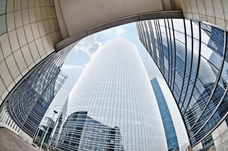Large skyscrapers shot with a fisheye lensLa Défense major business district near Paris, France Stock Photo