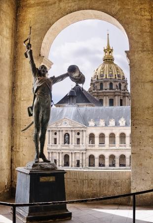 invalides: PARIS, FRANCE - APRIL 10   Long live the Emperor    Statue of a French soldier, greeting Napoleon at Les Invalides, Paris, France