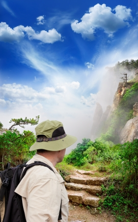 figure of a tourist looking into magnificent view of the mountains photo