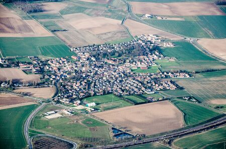 remoteness: View from the plane on small town in France