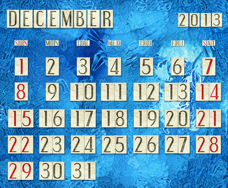 Calendar December 2013 on the frost-covered glass photo
