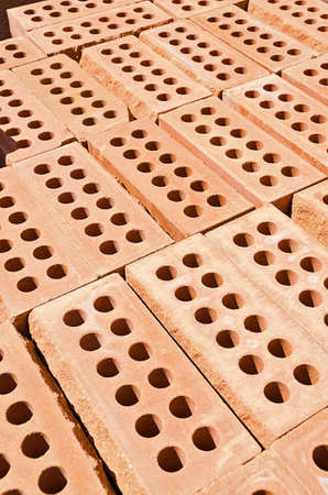Stack of red clay bricks photo