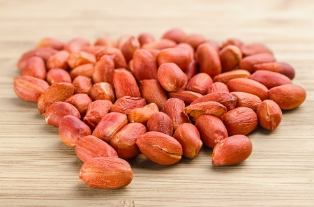 red skinned: red skinned roasted peanuts . Images collected from four shots to increase the zone of sharpness