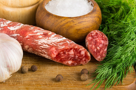 salame: sliced salame on cutting board, Focus area increased by folding multiple photos