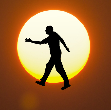 weightlessness: weightlessness on  amazing sunset Stock Photo