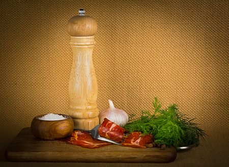 pepper castor: Still-life with bacon, dill, pepper and salt