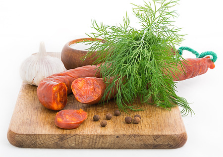 increased: Rustic still life with sausage, garlic and herbs Focus area increased by folding multiple photos