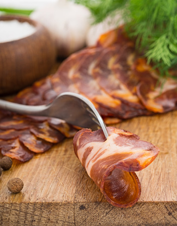 Bloated bacon screwed to the fork, very close   Focus area increased by folding multiple photos photo