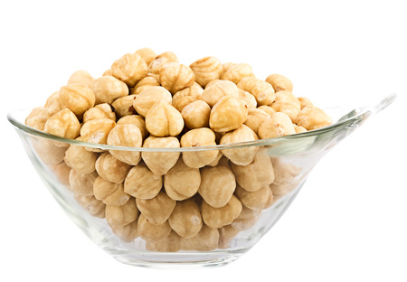 hazelnuts in glass piala  Isolation on white background   image collected from a few photos for larger areas of focus