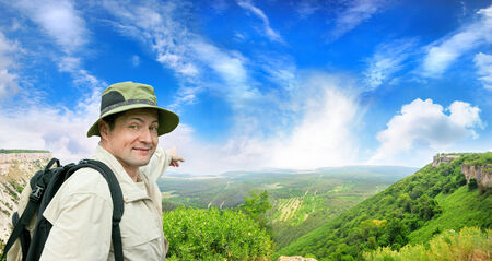 brisk: brisk tourist shows the direction on a country road Stock Photo