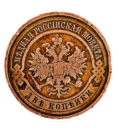 threadbare: Threadbare coat of arms of the Russian empire in the ancient copper coin Stock Photo